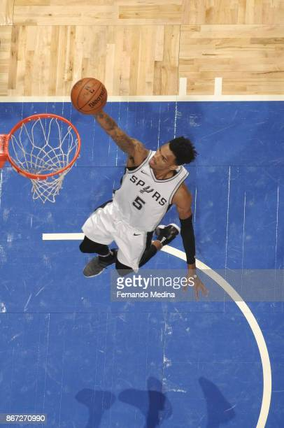 Dejounte Murray of the San Antonio Spurs drives to the basket against the Orlando Magic on October 27 2017 at Amway Center in Orlando Florida NOTE TO...