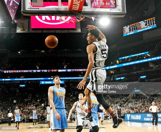 Dejounte Murray of the San Antonio Spurs dunks against the Denver Nuggets at ATT Center on November 5 2016 in San Antonio Texas NOTE TO USER User...