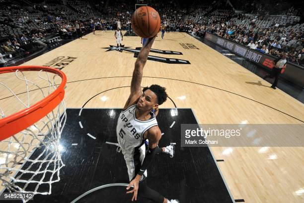 Dejounte Murray of the San Antonio Spurs dunks the ball against the Golden State Warriors during Game Three of the Western Conference Quarterfinals...