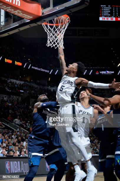 Dejounte Murray of the San Antonio Spurs goes to the basket against the Minnesota Timberwolves on October 18 2017 at the ATT Center in San Antonio...