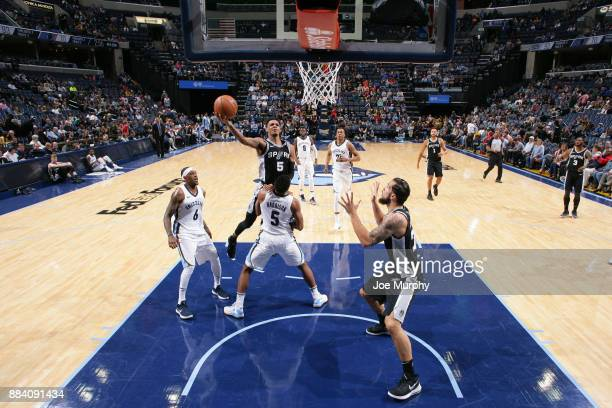 Dejounte Murray of the San Antonio Spurs goes to the basket against the Memphis Grizzlies on December 1 2017 at FedExForum in Memphis Tennessee NOTE...