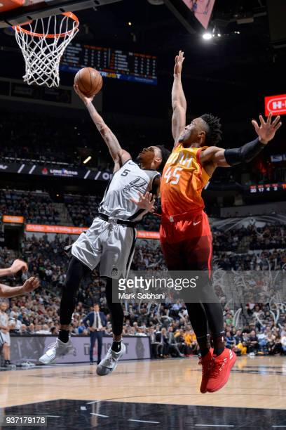 Dejounte Murray of the San Antonio Spurs goes to the basket against the Utah Jazz on March 23 2018 at the ATT Center in San Antonio Texas NOTE TO...