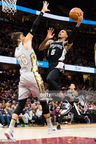 Dejounte Murray of the San Antonio Spurs goes up for a shot against Kyle Korver of the Cleveland Cavaliers during the second half at Quicken Loans...