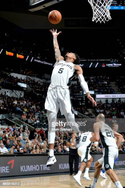 Dejounte Murray of the San Antonio Spurs grabs the rebound against the Detroit Pistons on December 4 2017 at the ATT Center in San Antonio Texas NOTE...