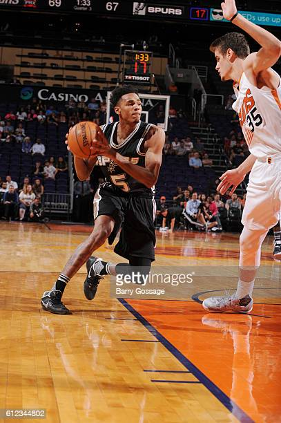 Dejounte Murray of the San Antonio Spurs handles the ball against the Phoenix Suns during a preseason game on October 3 2016 at Talking Stick Resort...