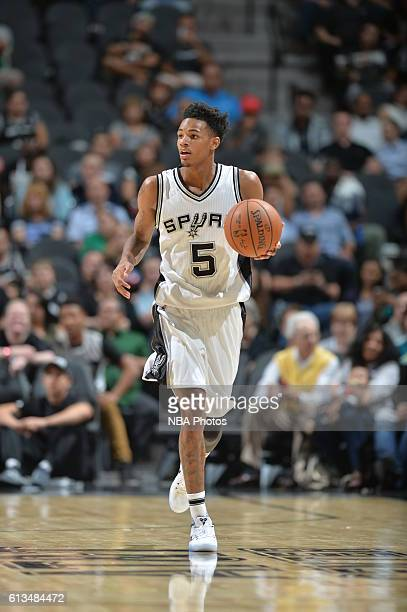 Dejounte Murray of the San Antonio Spurs handles the ball against the Atlanta Hawks on October 8 2016 at the ATT Center in San Antonio Texas NOTE TO...