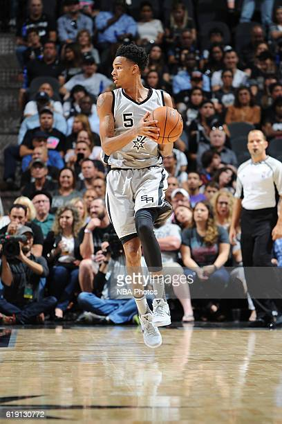 Dejounte Murray of the San Antonio Spurs handles the ball against the New Orleans Pelicans on October 29 2016 at the ATT Center in San Antonio Texas...