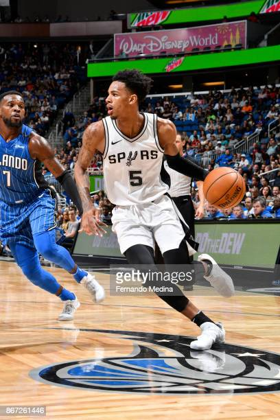Dejounte Murray of the San Antonio Spurs handles the ball against the Orlando Magic on October 27 2017 at Amway Center in Orlando Florida NOTE TO...