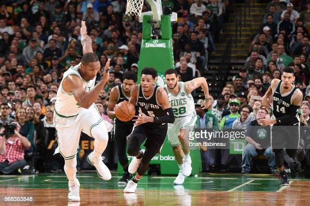 Dejounte Murray of the San Antonio Spurs handles the ball against the Boston Celtics on October 30 2017 at the TD Garden in Boston Massachusetts NOTE...
