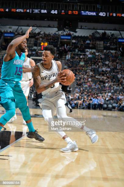 Dejounte Murray of the San Antonio Spurs handles the ball against the Charlotte Hornets on November 3 2017 at the ATT Center in San Antonio Texas...