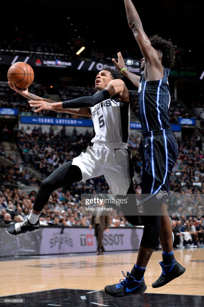 Dejounte Murray #5 of the San Antonio Spurs handles the ball against the Orlando Magic on March 13, 2018 at the AT&T Center in San Antonio, Texas.