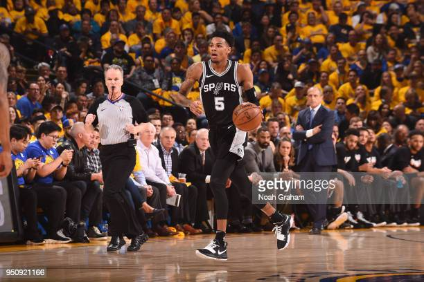 Dejounte Murray of the San Antonio Spurs handles the ball against the Golden State Warriors Game Five of Round One of the 2018 NBA Playoffs on April...