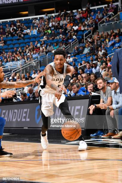 Dejounte Murray of the San Antonio Spurs passes the ball against the Orlando Magic on October 27 2017 at Amway Center in Orlando Florida NOTE TO USER...