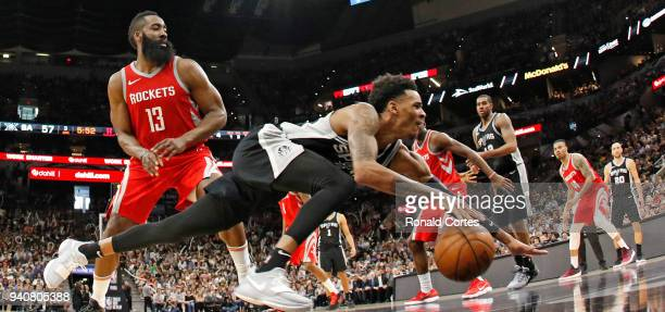 Dejounte Murray of the San Antonio Spurs reaches of the ball after being fouled by James Harden of the Houston Rockets at ATT Center on April 1 2018...