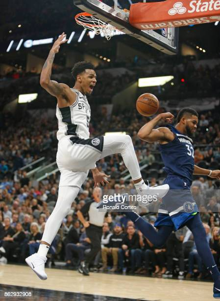 Dejounte Murray of the San Antonio Spurs reacts after dunking past KarlAnthony Towns of the Minnesota Timberwolves at ATT Center on October 18 2017...