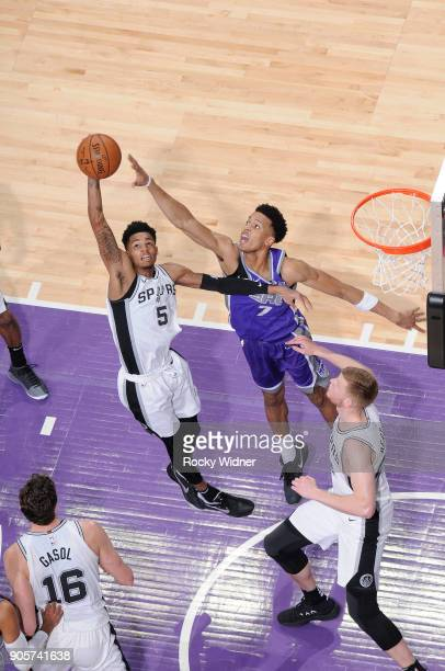 Dejounte Murray of the San Antonio Spurs rebounds against Skal Labissiere of the Sacramento Kings on January 8 2018 at Golden 1 Center in Sacramento...