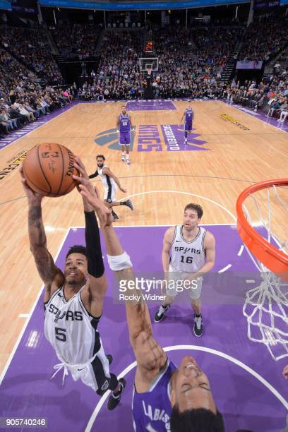 Dejounte Murray of the San Antonio Spurs rebounds against the Sacramento Kings on January 8 2018 at Golden 1 Center in Sacramento California NOTE TO...