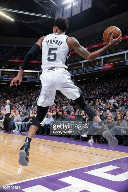 Dejounte Murray of the San Antonio Spurs saves the ball against the Sacramento Kings on January 8 2018 at Golden 1 Center in Sacramento California...