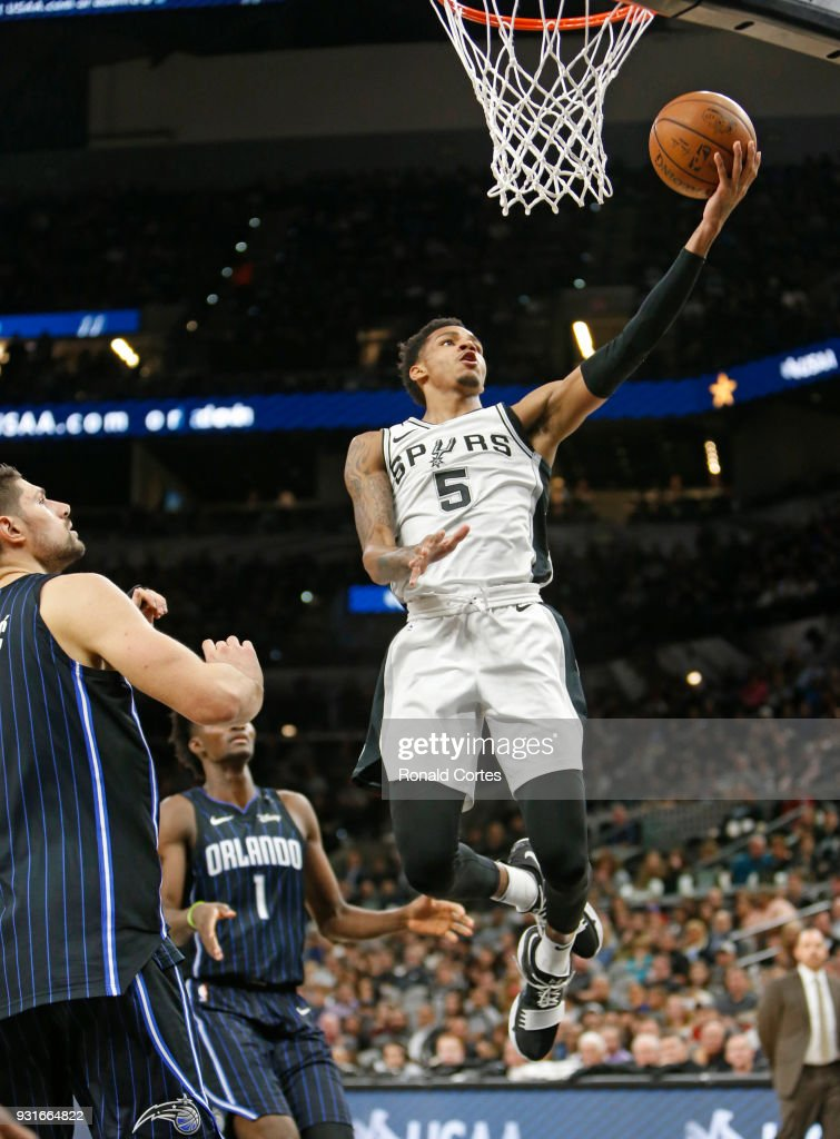 Dejounte Murray #5 of the San Antonio Spurs scores two against the Orlando Magic at AT&T Center on March 13, 2018 in San Antonio, Texas.