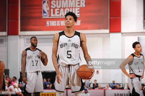 Dejounte Murray of the San Antonio Spurs shoots a free throw against the Minnesota Timberwolves during the 2016 NBA Las Vegas Summer League game on...