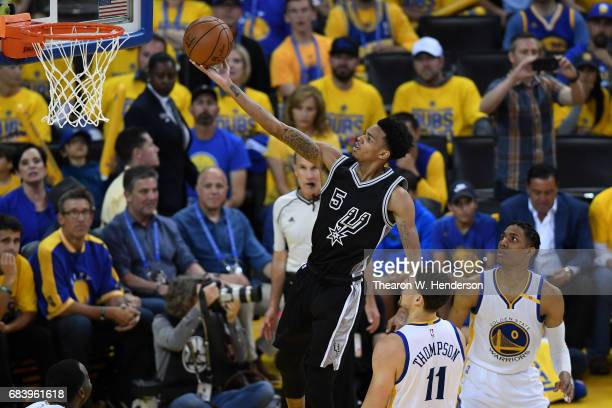 Dejounte Murray of the San Antonio Spurs shoots a layup against the Golden State Warriors during Game Two of the NBA Western Conference Finals at...