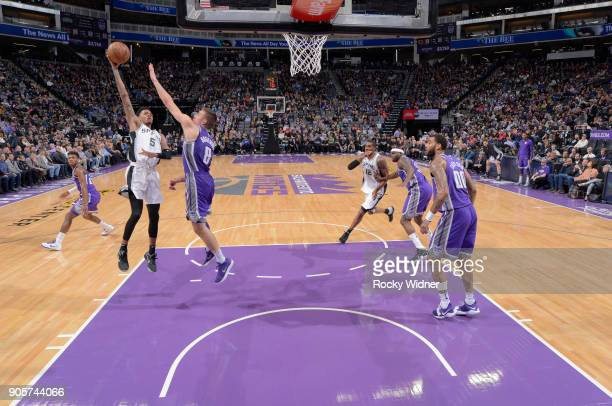 Dejounte Murray of the San Antonio Spurs shoots against Bogdan Bogdanovic of the Sacramento Kings on January 8 2018 at Golden 1 Center in Sacramento...