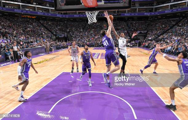 Dejounte Murray of the San Antonio Spurs shoots against Kosta Koufos of the Sacramento Kings on January 8 2018 at Golden 1 Center in Sacramento...