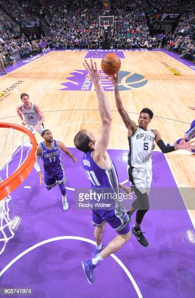 Dejounte Murray of the San Antonio Spurs shoots against the Kosta Koufos of the Sacramento Kings on January 8 2018 at Golden 1 Center in Sacramento...