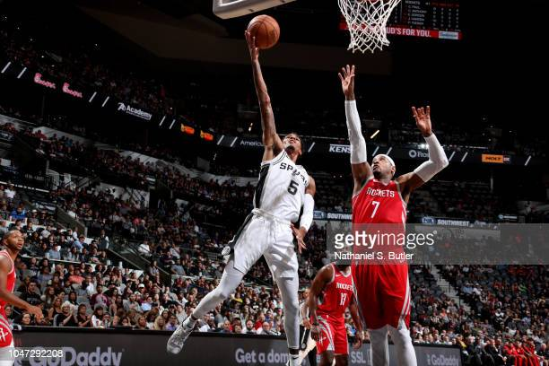 Dejounte Murray of the San Antonio Spurs shoots the ball against the Houston Rockets during a preseason game on October 7 2018 at ATT Center in San...