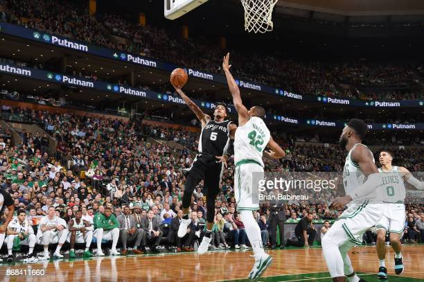 Dejounte Murray of the San Antonio Spurs shoots the ball against the Boston Celtics on October 30 2017 at the TD Garden in Boston Massachusetts NOTE...