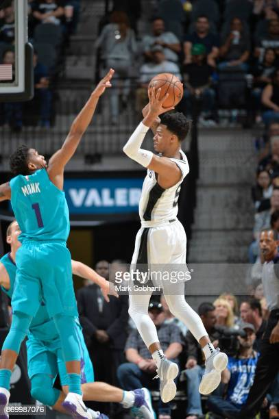 Dejounte Murray of the San Antonio Spurs shoots the ball against the Charlotte Hornets on November 3 2017 at the ATT Center in San Antonio Texas NOTE...