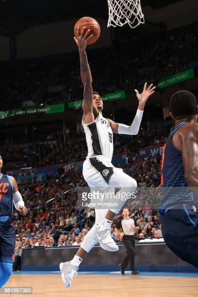Dejounte Murray of the San Antonio Spurs shoots the ball against the Oklahoma City Thunder on December 3 2017 at Chesapeake Energy Arena in Oklahoma...