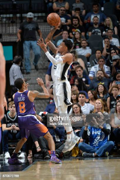 Dejounte Murray of the San Antonio Spurs shoots the ball during the game against the Phoenix Suns on November 5 2017 at the ATT Center in San Antonio...