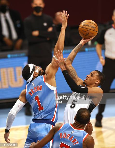 Dejounte Murray of the San Antonio Spurs takes a shot as Bruce Brown of the Brooklyn Nets defends in the first quarter at Barclays Center on May 12,...