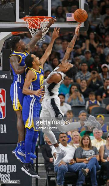 Dejounte Murray of the San Antonio Spurs tries to shoot over Shaun Livingston of the Golden State Warriors at ATT Center on November 2 2017 in San...