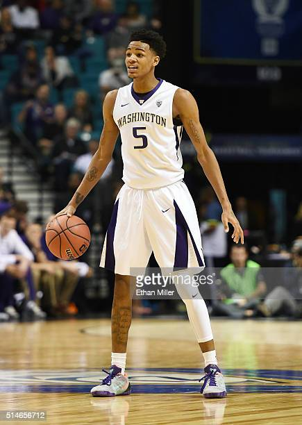 Dejounte Murray of the Washington Huskies brings the ball up the court against the Stanford Cardinal during a firstround game of the Pac12 Basketball...