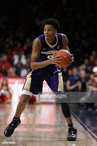 Dejounte Murray of the Washington Huskies looks to pass during the second half of the college basketball game against the Arizona Wildcats at McKale...