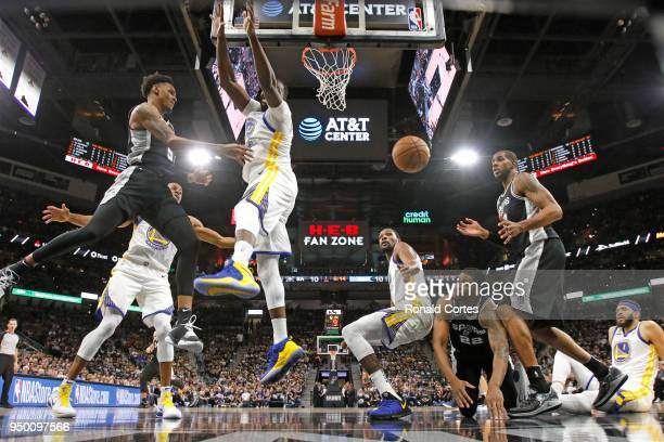 Dejounte Murray passes off to LaMarcus Aldridge of the San Antonio Spurs during game against the Golden State Warriors in the second half of Game...