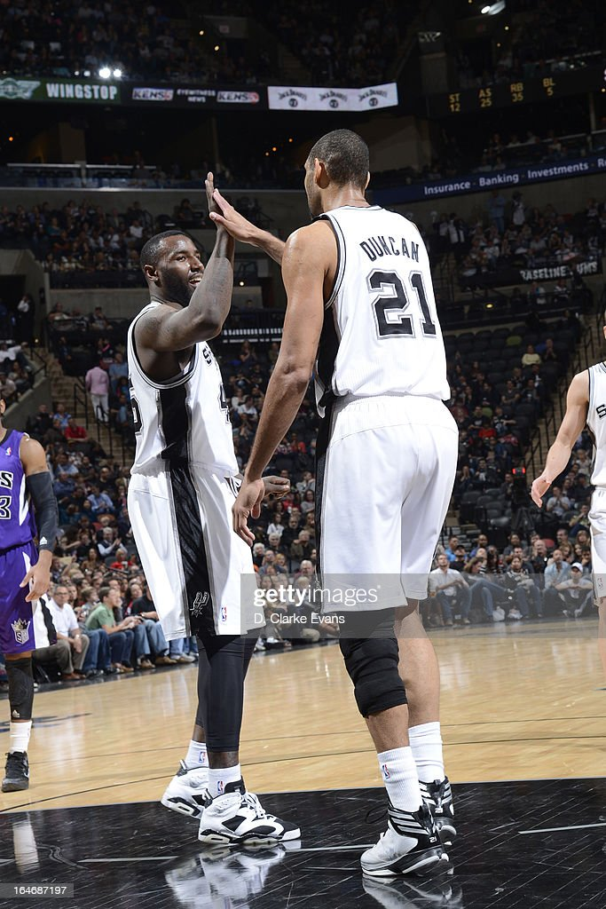 DeJuan Blair #45 and Tim Duncan #21 of the San Antonio Spurs congradulate each other during the game against the Sacramento Kings on March 1, 2013 at the AT&T Center in San Antonio, Texas.