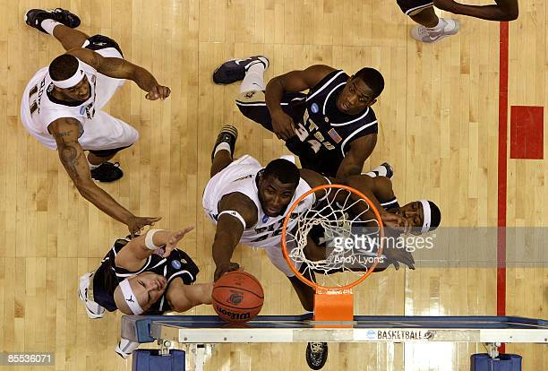 DeJuan Blair of the Pittsburgh Panthers drives to the hoop against Mike Smith Greg Hamlin and Isiah Brown of the East Tennessee State Buccaneers...