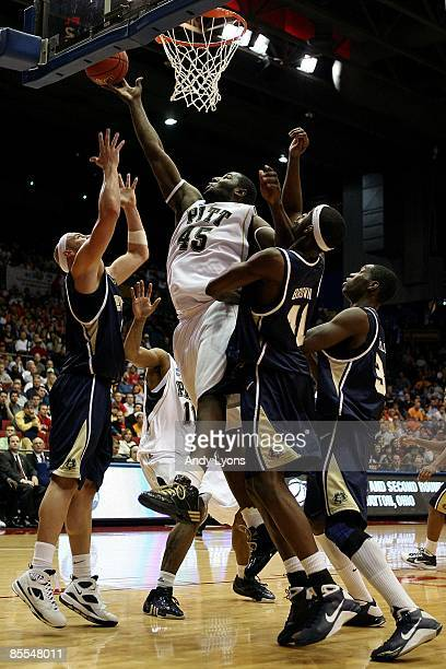 DeJuan Blair of the Pittsburgh Panthers drives to the hoop against Mike Smith and Isiah Brown of the East Tennessee State Buccaneers during the first...