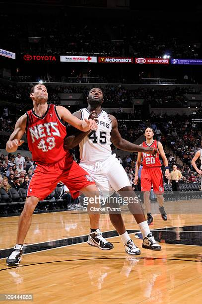 DeJuan Blair of the San Antonio Spurs battles for position against Kris Humphries of the New Jersey Nets at ATT Center on February 25 2011 in San...