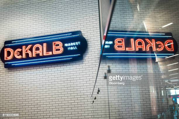 DeKalb Market Hall signage is displayed above escalators to the basement at City Point in the Brooklyn borough of New York US on Tuesday July 18 2017...