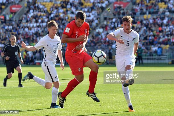 Deklan Wynne of the All Whites controls the ball from Aldo Corzo of Peru during the 2018 FIFA World Cup Qualifier match between the New Zealand All...
