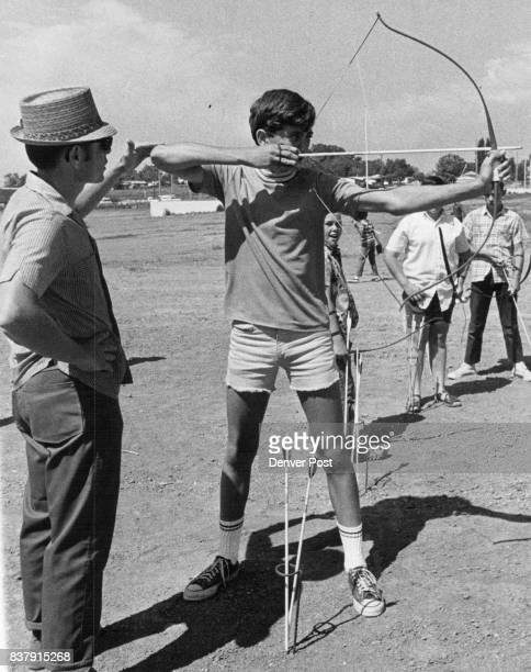 Del Befys teacher of archery corrects the arm attitude of Philip Cerise 701 Campo St Archery is one of most popular of class activities Credit Denver...