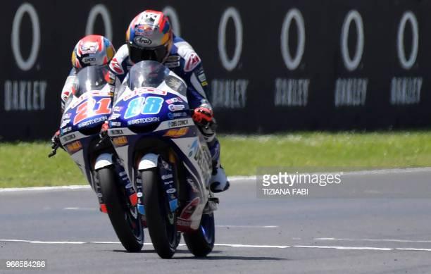 Del Conca Gresini Moto3 Spanish rider Jorge Martin and Del Conca Gresini Moto3 Italian rider Fabio Di Giannantonio compete during the Italian Grand...