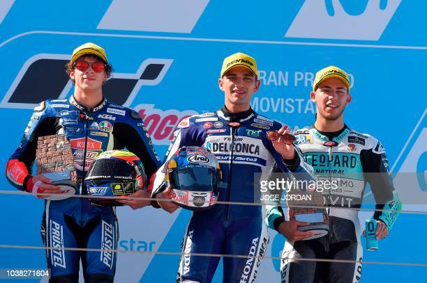 Del Conca Gresini Moto3's Spanish rider Jorge Martin celebrates next to Redox PruestelGP's Italian rider Marco Bezzecchi and Leopard Racing Moto3's...