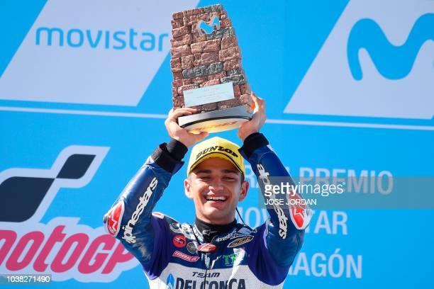 Del Conca Gresini Moto3's Spanish rider Jorge Martin celebrates on the podium after winning the Moto3 race of the Moto Grand Prix of Aragon at the...