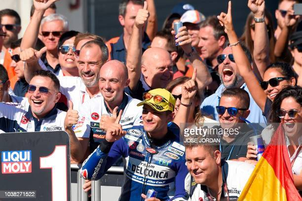 Del Conca Gresini Moto3's Spanish rider Jorge Martin celebrates with teammates after winning the Moto3 race of the Moto Grand Prix of Aragon at the...