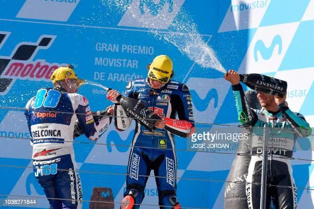 Del Conca Gresini Moto3's Spanish rider Jorge Martin celebrates with Redox PruestelGP's Italian rider Marco Bezzecchi and Leopard Racing Moto3's...